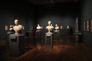 Sculptures of heads in dark museum
