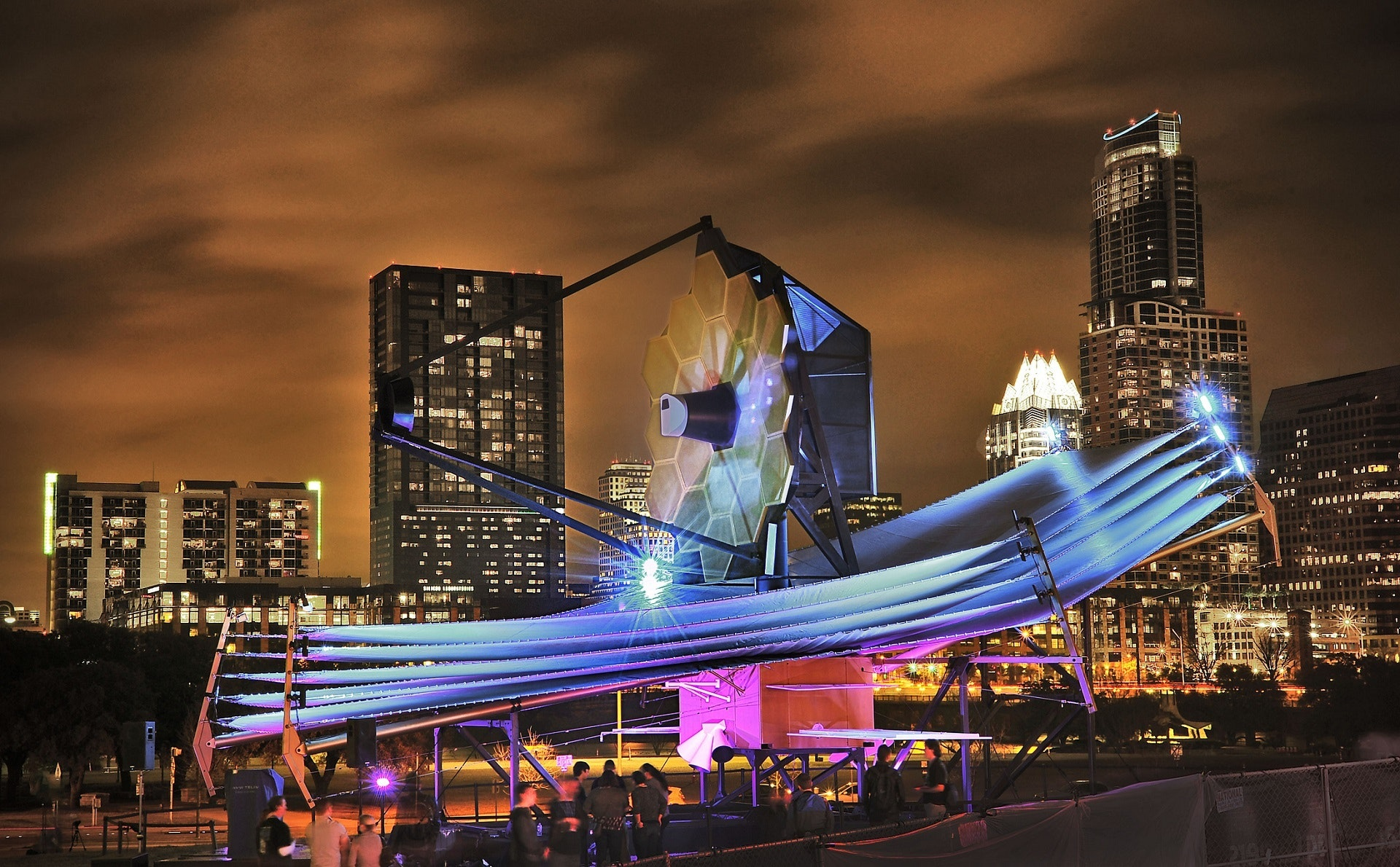 Hire event staff to construct a technological tensile structure art installation.